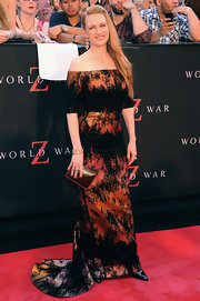 Mireille Enos held a metallic hard case clutch at the red carpet premiere of 'World War Z.'