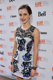 Emma Watson styled her ladylike dress with edgy silver Yves Saint Laurent cuffs on both wrists when she attended the premiere of 'The Perks of Being a Wallflower.'