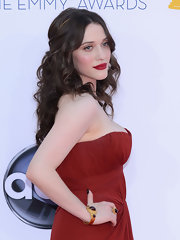 Kat Dennings teamed a gemstone bracelet and a matching ring with a strapless Grecian gown for her Emmys look.