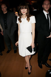 Keira Knightley added a sweet touch with a black Valentino bow clutch.