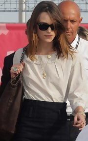 Keira Knightley looked a little shy in her Ray-Ban wayfarers as she arrived for the Venice Film Festival.