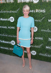 Julie Macklowe matched her bright dress with a pair of simple nude pointy pumps.