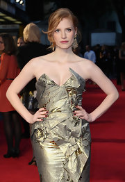 Jessica Chastain looked fierce in a metallic dress paired with dark red mani at the 'Debt' UK premiere.