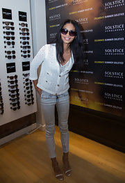 Chanel Iman was casual-chic in a perforated white cardigan during the Solstice Sunglasses Summer Soiree.