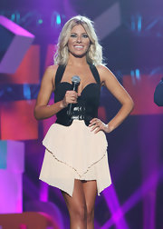 Mollie King punctuated her look with a broad black belt.