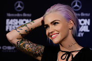 Ruby Rose dyed her hair lavender and blue, and wore it slicked away from her face.