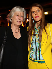 Anna dello Russo did some color blocking, teaming a green belt with a blue button-down and a yellow pantsuit.