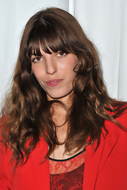 Lou Doillon wore tousled curls with her signature bangs during the Givenchy fashion show.