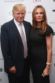 Melania Trump added some sparkle to her LBD with a broad diamond bracelet when she attended the screening of 'Cheri.'