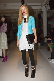 A black crocodile shoulder bag finished off Joanna Hillman's look in ultra-chic style.