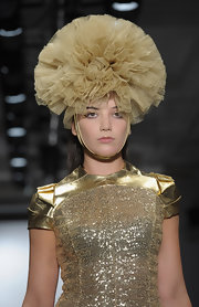 Daisy Lowe sported a gold ruffle headdress to match her bodysuit at the Pam Hogg Spring 2011 show.