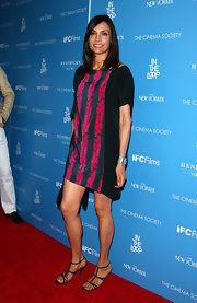 Simple yet chic was Famke Janssen's inspiration as she wore a mini dress and a pair of strappy heels at a movie screening.