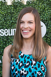 Hilary Swank left her hair loose with a side part when she attended the Couture Council Fashion Visionary Awards.
