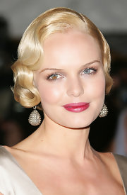 Kate Bosworth attended the Met Gala wearing massive crystal drop earrings and a vintage-glam hairstyle.