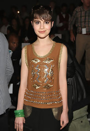 Sami Gayle added some color to her neutral outfit with a trio of jade bangles when she attended the Tracy Reese fashion show.