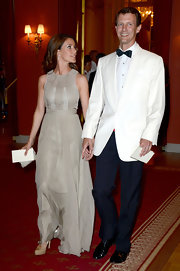 Princess Marie donned a sleeveless tan gown for the private dinner on the eve of Princess Madeleine and Christopher O'Neill's wedding.