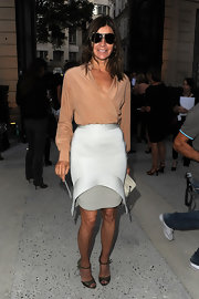 Carine Roitfeld went for classic sophistication in a nude silk wrap top during the YSL fashion show.