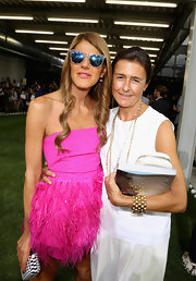 Anna dello Russo attended the Moncler Gamme Bleu fashion show looking hip in her blue wayfarers.