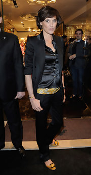 Ines de la Fressange styled her all-black outfit with mustard yellow kicks at Roberto Cavalli's boutique launch.