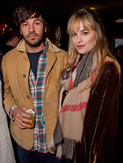 Dakota Johnson bundled up in a cozy patterned scarf for the Jameson Petty Fest.