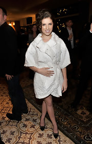 Anna Kendrick bundled up in a textured white coat for the Pieces of Heaven event.