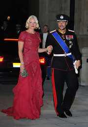 Princess Mette-Marit polished off her look with a beaded silver clutch.