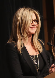 Jennifer Aniston accessorized with a gold pendant for some shine to her black outfit at the screening of 'Five.'