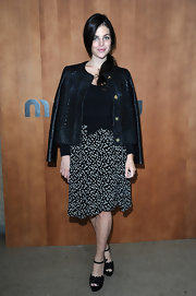 Julia Restoin-Roitfeld chose a pair of black ankle-strap platform sandals to team with her outfit.