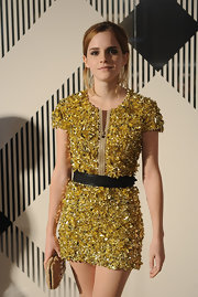 Emma Watson dazzled in a gold sequin dress cinched with a plaited black belt, both by Burberry, during the label's fashion show.