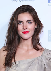 Hilary Rhoda swiped on some bright red lipstick for a popping beauty look.