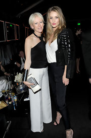 Rosie Huntington-Whiteley finished off her chic ensemble with a pair of skinny black silk pants.