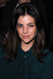 Julia Restoin-Roitfeld sported her usual center-parted style when she attended the Louis Vuitton fashion show.