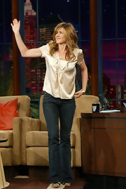 Jennifer Aniston chose a pair of blue flare jeans to seal off her look.