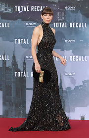 Jessica Biel paired a black and gold Fendi clutch with a sparkly halter gown for the 'Total Recall' Berlin premiere.