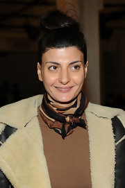 Giovanna Battaglia topped off her neutral-themed outfit with a black, brown, and nude patterned scarf.