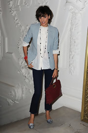 Ines de la Fressange topped her white button down shirt with a blue blazer at Paris Fashion Week.