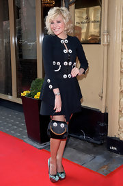 Pixie Lott went for quirky elegance in a Moschino googly eye-embellished jacket at the Tesco Magazine Mum of the Year event.