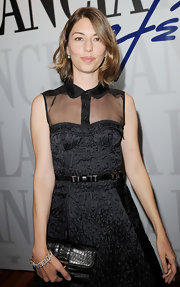 Sofia Coppola paired a Pomellato diamond chain bracelet with a sheer-panel LBD for the Venice Film Festival.