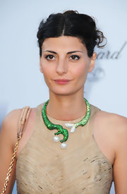 Giovanna Battaglia styled her dress with a chunky green collar necklace during the amfAR Cinema Against AIDS Gala.