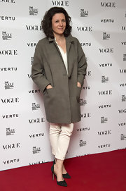 Garance Dore arrived for the Vogue Festival wearing a gray wool coat with cream-colored pants.