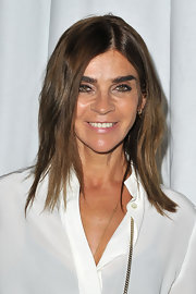 Carine Roitfeld attended the Givenchy fashion show wearing her hair in tousled layers.