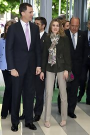 Princess Letizia donned a tough-chic army-green suede jacket for the World Red Cross Day celebration.