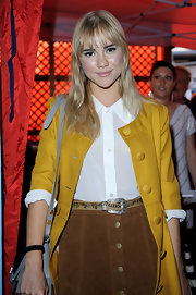 Suki Waterhouse spruced up her skirt with a printed belt when she attended the British Heart Foundation party.