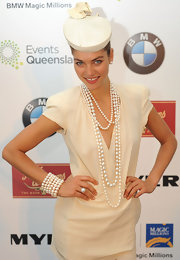 Jessica Hart sealed off her look with an embellished white pillbox hat.