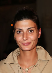 Giovanna Battaglia styled her hair into a slicked-back bun for the Thakoon fashion show.