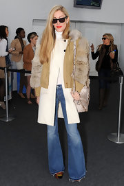 A pair of bell-bottom jeans lent a '70s vibe to Joanna Hillman's look.