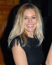 Sienna Miller wore a slightly teased, center-parted 'do to the Twenty8Twelve fashion show.