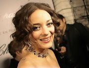 Marion Cotillard polished off her look with a lovely gemstone choker.