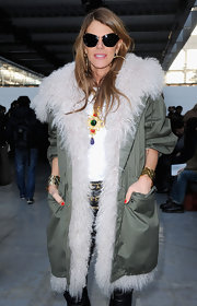 A pair of butterfly sunnies added major coolness to Anna dello Russo's look.