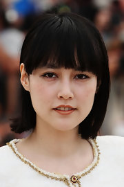Rinko Kikuchi opted for a casual short cut with bangs when she attended the Cannes Film Festival photocall for 'Map of the Sounds of Tokyo.'